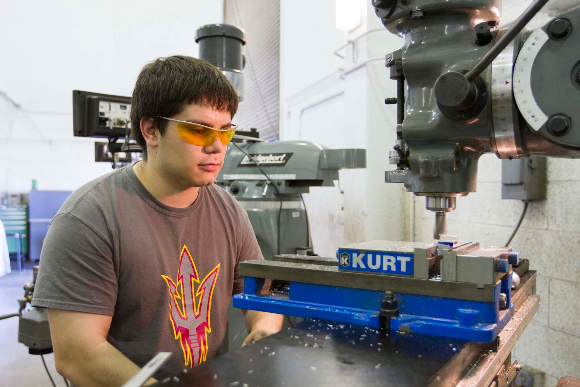 A manufacturing engineering student works in a lab